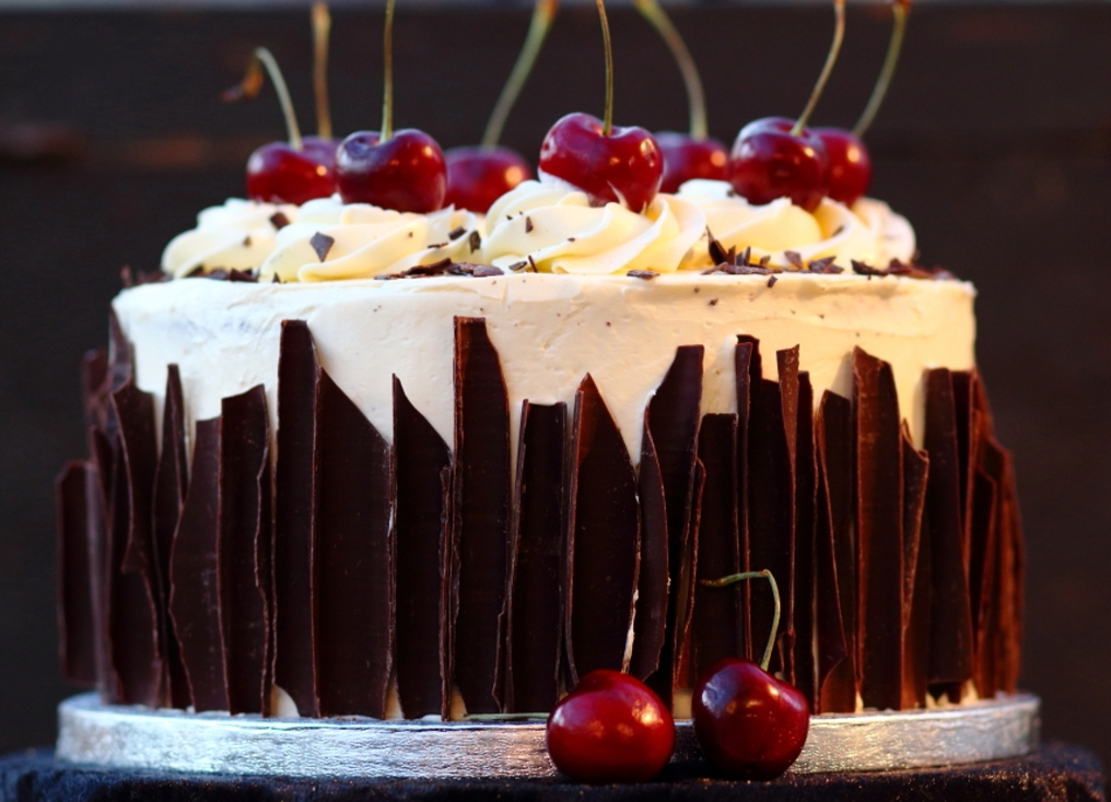 Grayshott Surrey stylish elegant black forest cake decorated with chocolate shards and fresh cherries