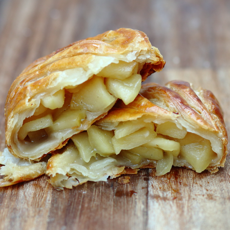 Apple turnover patisserie broken in half, filled with apple chunks, made by Lovingly Baked by Anthea in Grayshott Surrey