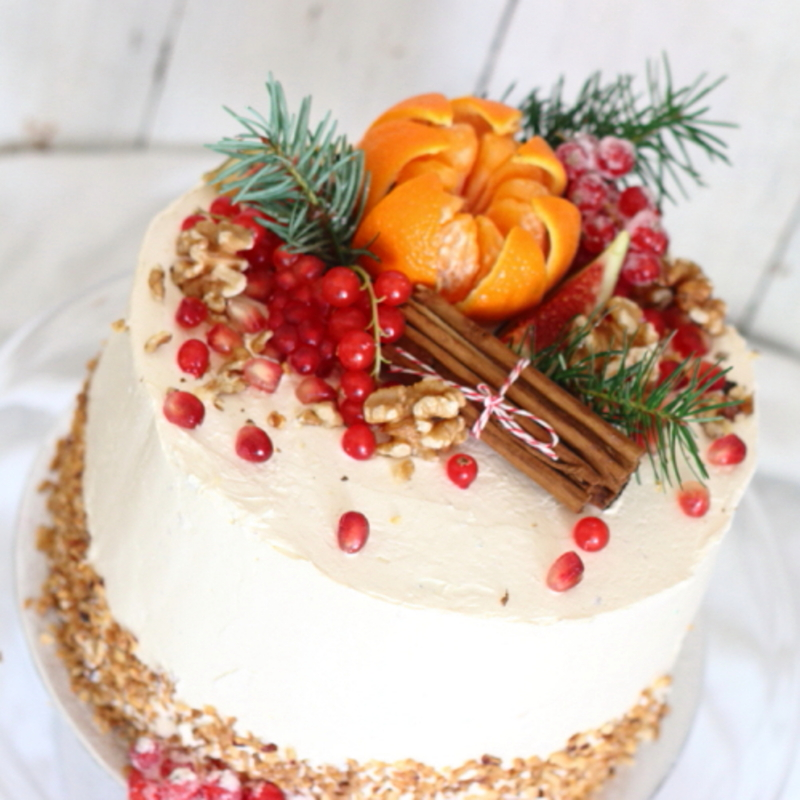 Carrot and walnut cake decorated with clementine and walnuts, made by Lovingly Baked by Anthea in Grayshott Surrey