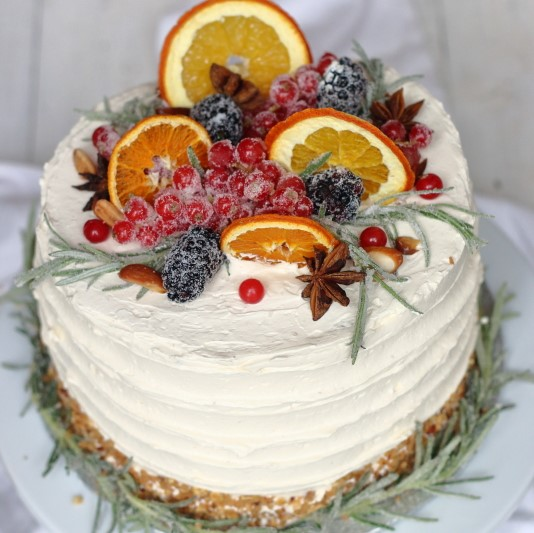 Cake decorated with orange slices, redcurrants, rosemary and almonds, to order online by Lovingly Baked by Anthea